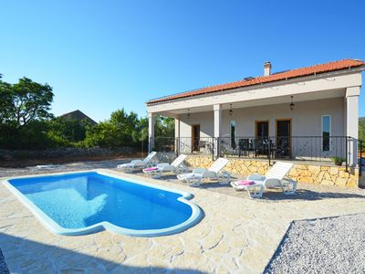 Photo for This 3-bedroom villa for up to 5 guests is located in Dubrava kod Sibenika and has a private swimmin