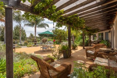 Large enchanted garden, water fountain, lots of places to enjoy wine & family