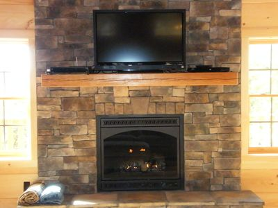 rock gas fireplace with LCD TV, blu-ray, sat dish very cozy and romantic