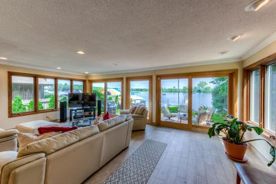 "Living Room overlooking Wayzata Bay. 55"" TV"