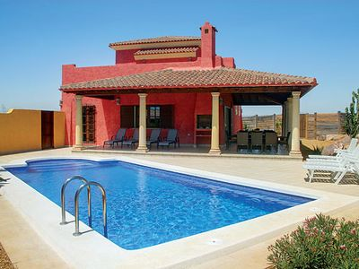 Photo for Resort villa w/ golf course, restaurants and stunning view of the mountain