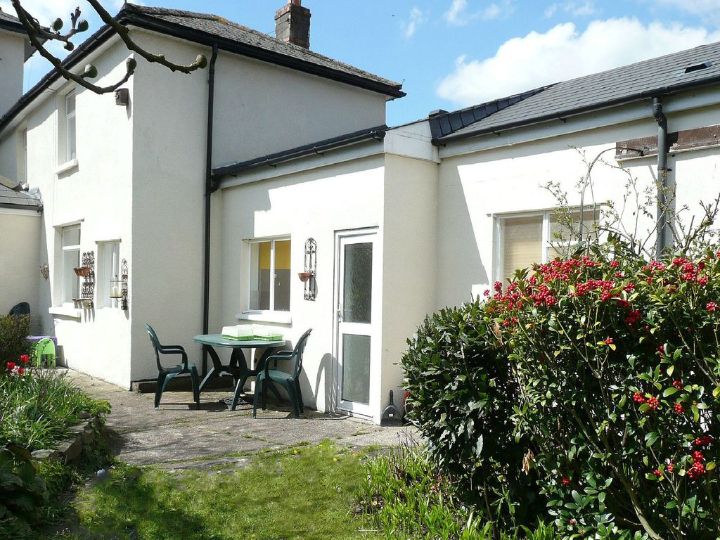 Property adjoing the owners' home in the village of Taff's Well,
