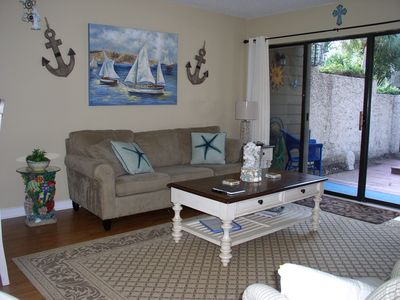 Photo for Beautiful condo w/ private courtyards; only 5 min. walk to beach & Coligny Plaza