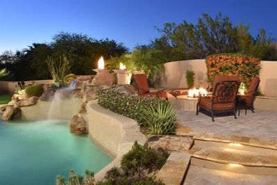 Outdoor living waterfall, fire bowls, fire pits, and plush outdoor furnitur