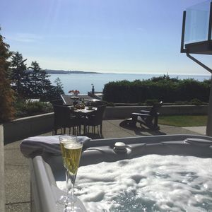 Picture yourself...here! The stunning ocean/city view from  our new Hot Tub!