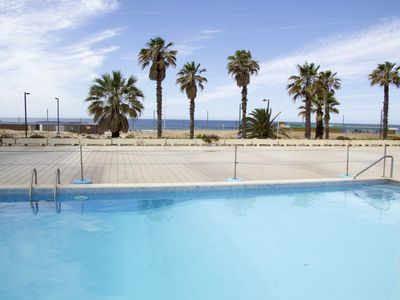 Photo for Beachfront Apartment with Pool & Parking