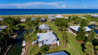 Photo for Island Breeze:  Private dock on south canal,  golf cart, steps to the beach!