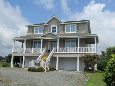 Photo for This beautiful Water Front Vacation Home offers you a Private Fishing Pier and Spectacular Views of the Intracoastal Waterway!