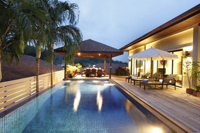 Beautiful teak style sun deck and private swimming pool