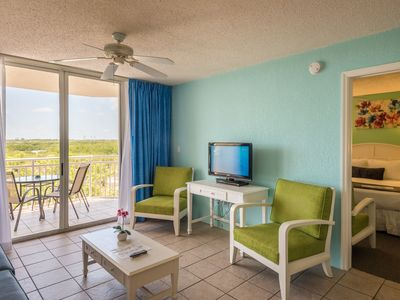 Photo for Breezy condo w/ shared pool & hot tub, private parking & great location - dog OK