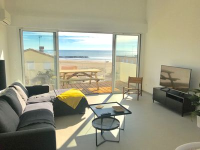 Photo for Superb new apartment facing the sea, located in 2nd line! Terrace and garage