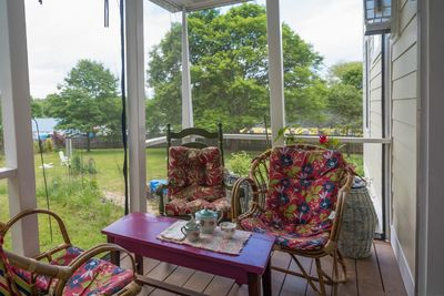 The cool screened north porch or veranda