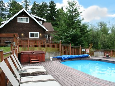 Photo for Incredible home on the lake. Your own private resort. Hot tub, pool, dock, etc.!