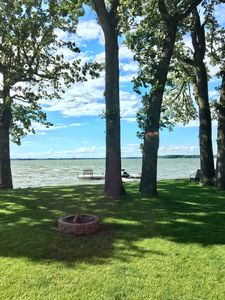 View of the lake from the Liv Room.  Majestic oaks provide dappled shade & sun.