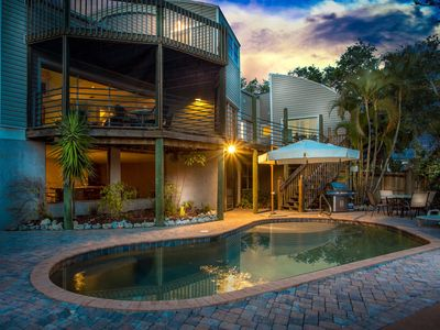 spectacular architectural home steps to the beach w/private heated pool on canal