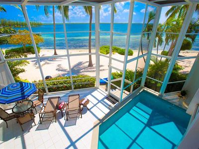 Photo for Pools of the Kai #6: Modern Island Oasis with Indoor Pool and Sandy Beach Living in Cayman Kai