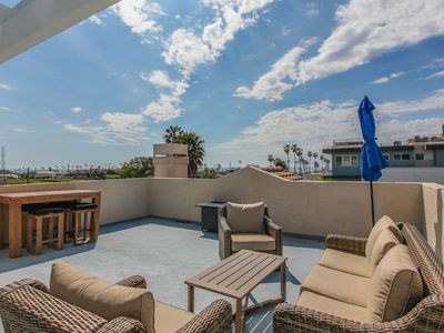 Photo for Modern home w/ gas fireplace, rooftop patio, & ocean views - close to the beach!