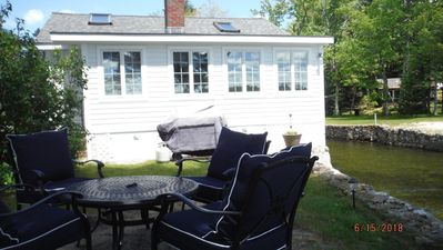 The cottage on the waterfront side with our Chat Set and Whittemore Brook