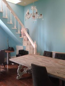 Lovely dining area with chandelier. Stair goes to loft 3rd bedrm.