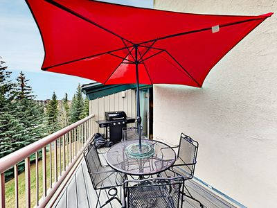 Balcony  - A private balcony comes with a gas grill, 4-person patio table, and a pair of rockers.