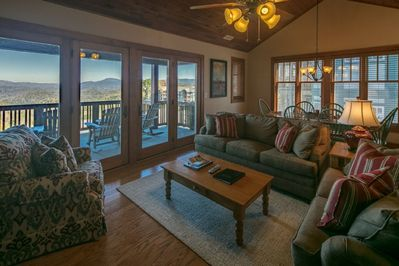 Living Room with Picture Windows and Mountain View