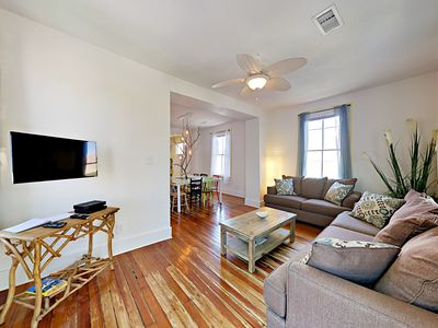 Photo for One-Of-A-Kind 4BR w/ Deck & Private Parking - Stroll to the Beach