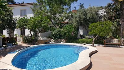 Photo for Spacious Farmhouse ideally located, Mature Garden, Private Pool & Stunning Views