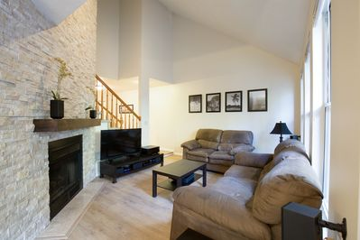"""Living room with 50"""" HDTV with surround sound, DVD player, and Roku."""