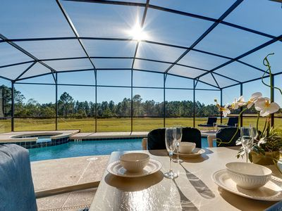 Photo for Stunning luxury 5 bed villa with pool near Disney in peaceful conservation area