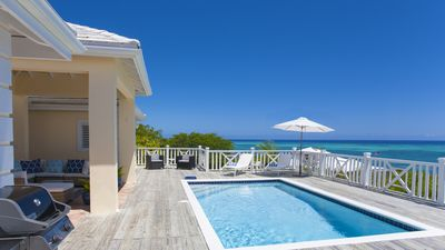 Photo for White Osprey: Spectacular views from every room and pool overlooking the ocean