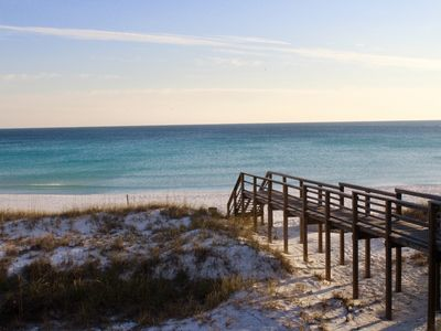 Photo for AFFORDABLE BEACH GETAWAY. The beach 60 seconds close to you- Next to the pool