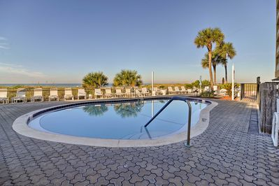 Spend your days at the pristine community pool or walk to the beach!