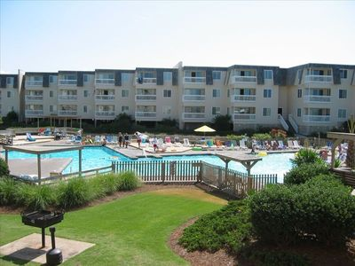 Photo for Beach Front Condo Complex - Vacation Steps Away From the Beach!  2 Pools!