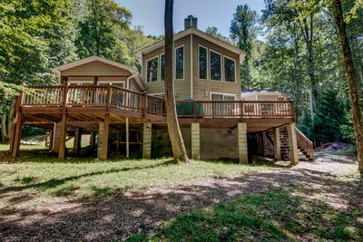Creekside view of the house. Wrap around deck, shade and sun.
