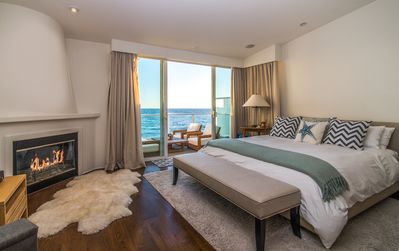 Luxurious master bedroom with stunning ocean views.