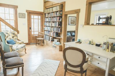 Library with large desk & built-in bookcase is the central feature of the house