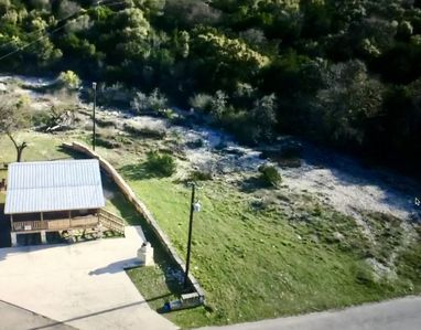 RIVER ROAD RETREAT - LOCATED ON SHUT-IN CREEK IN THE HEART OF CONCAN, WITH MOUNTAIN VIEWS AND WALK TO THE FRIO RIVER.