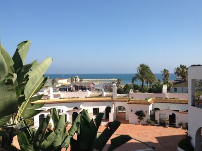 Photo for Split Level Apartment in Puerto Cabopino with superb views of port and beach