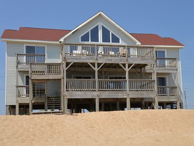 Photo for Oceanfront sitting right on the BEACH! Enjoy watching dolphins from the deck-385