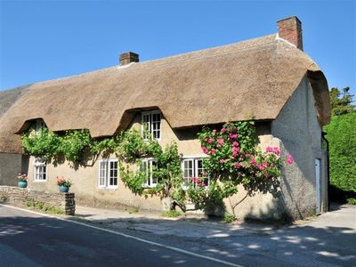 Photo for Thatched cottage at Studland Bay close to beach on World Heritage site.