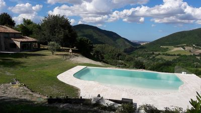 Photo for Villa Marche countryside nestled in the hills, with private pool, sea view