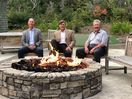 Golfers enjoying the firepit after a round.