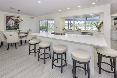 Island bar top counter with swivel barstools