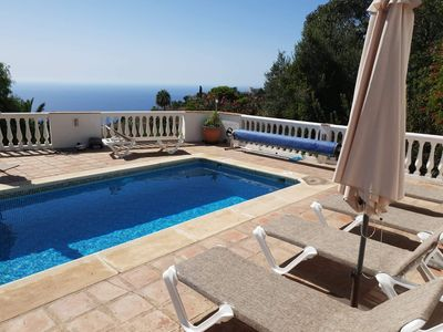 Photo for Charming villa with sunny terrace, heated pool all year and stunning views