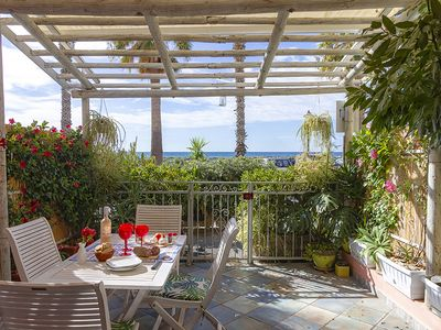 Photo for FIRST LINE SEA EDGE GROUND FLOOR-LIVING AND FURNISHED PATIO-CHARMING RESIDENCE