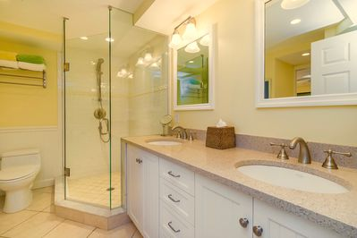 Bathroom Has a Spacious Walk-In Glass Shower With A Double Sink Quartz Vanity