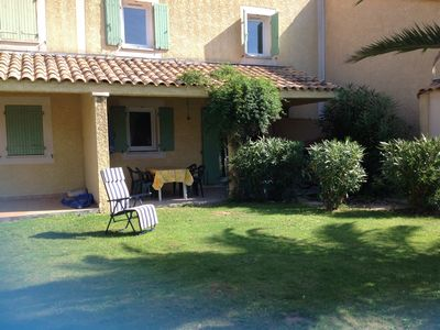 Photo for Canal side Villa with sunny garden and shared pools
