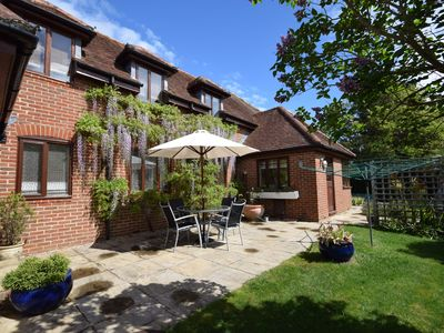 Photo for Garden Flat -  comfortable cottage for two close to Chichester and Goodwood