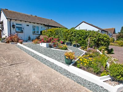 Photo for Ideal holiday bungalow with pretty garden and water features - pet friendly