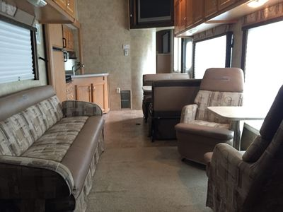 Comfortable main cabin with kitchen, dining and a smart TV.